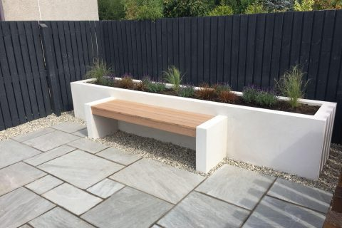 The new hardwood seat and contemporary raised bed