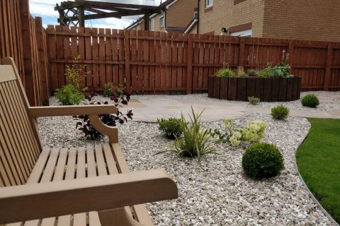 The existing bench was given a new home amongst the planting