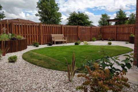 The existing lawn was reshaped and edged in aluminium with gravel to surrounding area