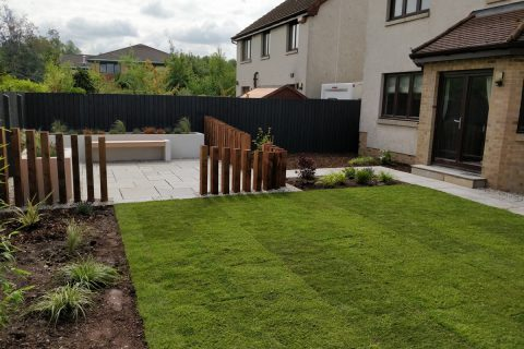 View across the new lawn to the main patio