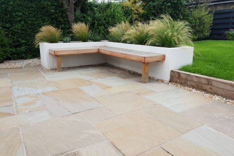 The new bespoke seat with the sandstone patio