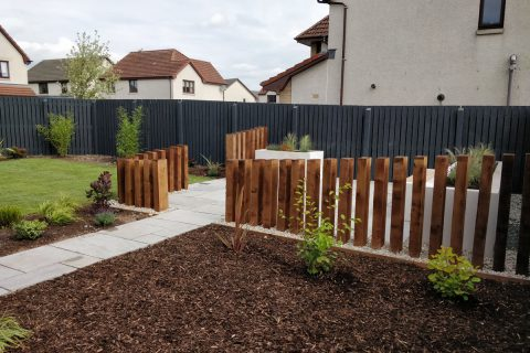 The bark area to the side of the patio has space for play equipment