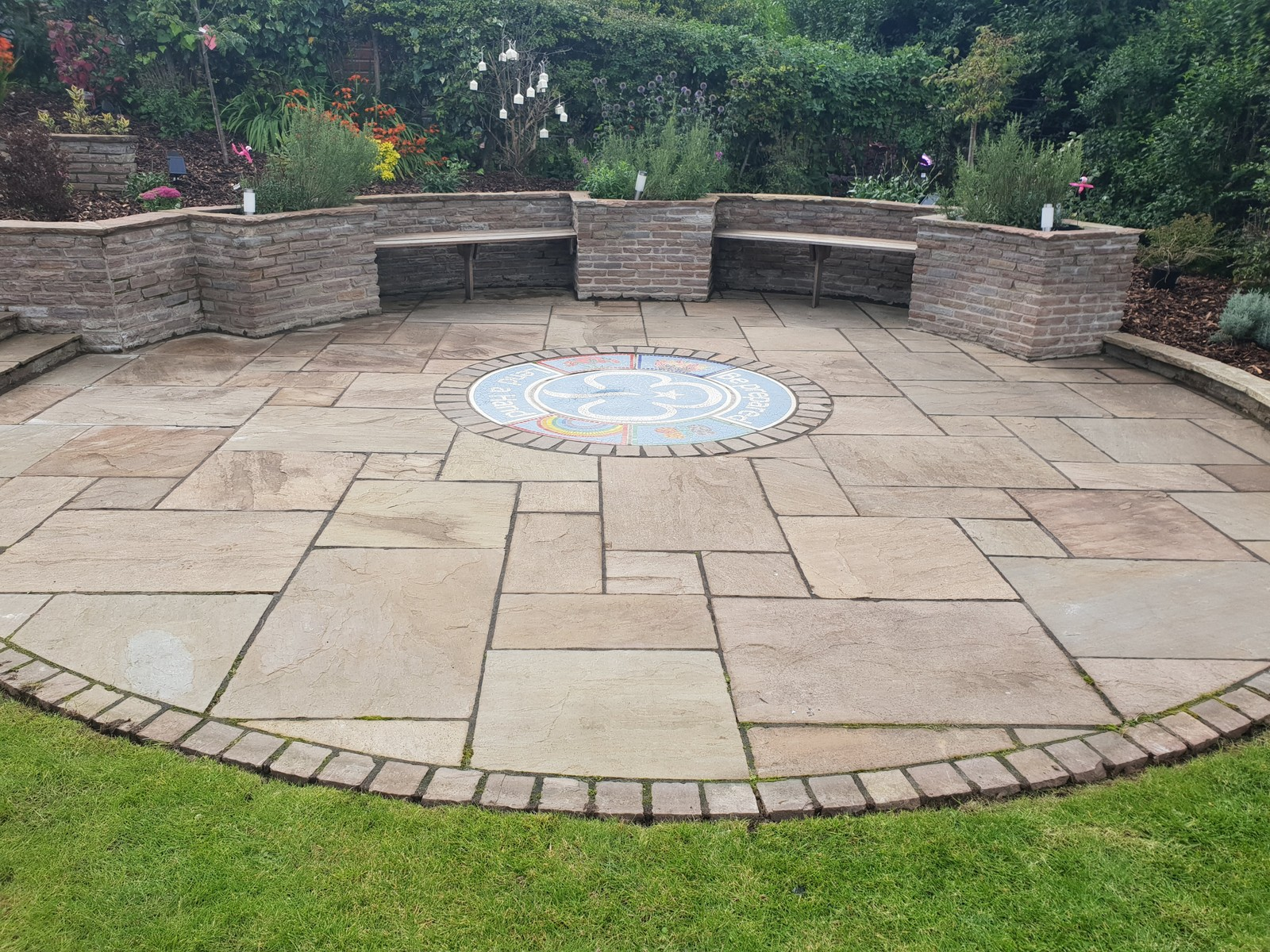 Sandstone patio with inset mosaic