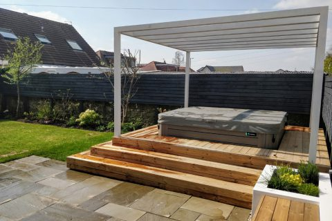 The slate grey fence creates a clean back drop to the garden