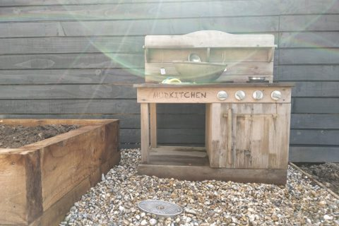 The mud kitchen still has a home in the new garden
