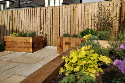 Gaps in the raised beds allow wheelchair access to allow the lovely planting