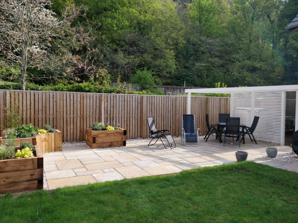After: new paths, patios, raised beds and pergola transform the space