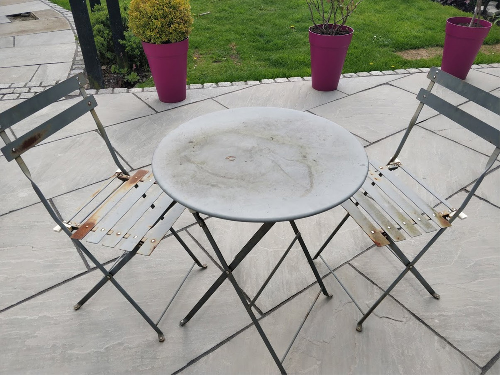 A rusty old bistro set needing some TLC