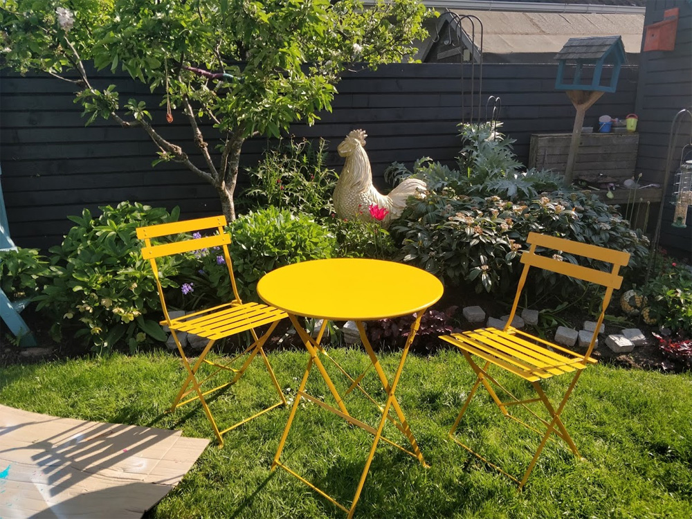 A lovely yellow paint adds a colourful splash of colour to the table and chairs