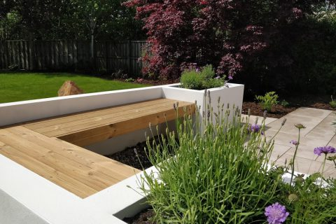 Hardwood benches top the rendered seating