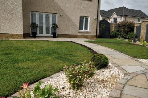 A path links the two new patios together
