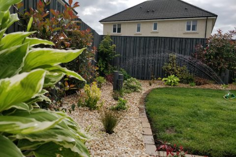 New gravel borders are filled with beautiful planting