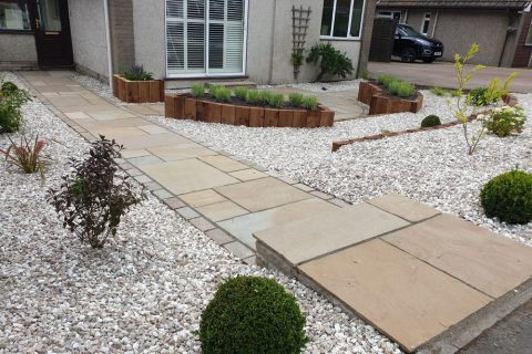 A gravel finish makes the garden low maintenance