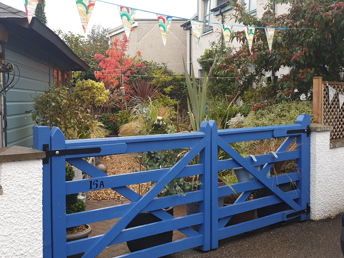 Another painted gate, this one a bold blue and in a traditional style. It works beautifully with all the colours beyond.