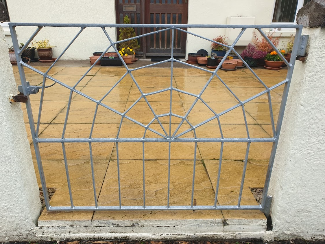 A cobweb gate adds a spooky slant to the garden - perfect for Halloween!