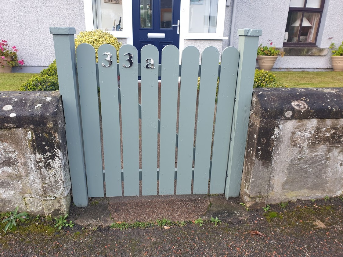 Another simple picket style gate. We like the curved tops and the choice of paint colour