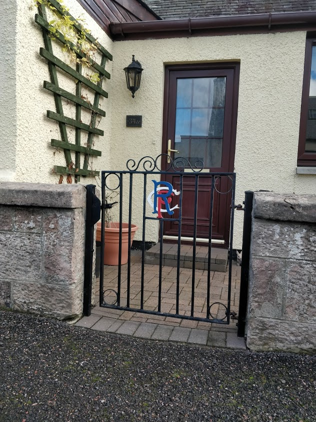 Clearly a gate leading to a Rangers' supporters house!