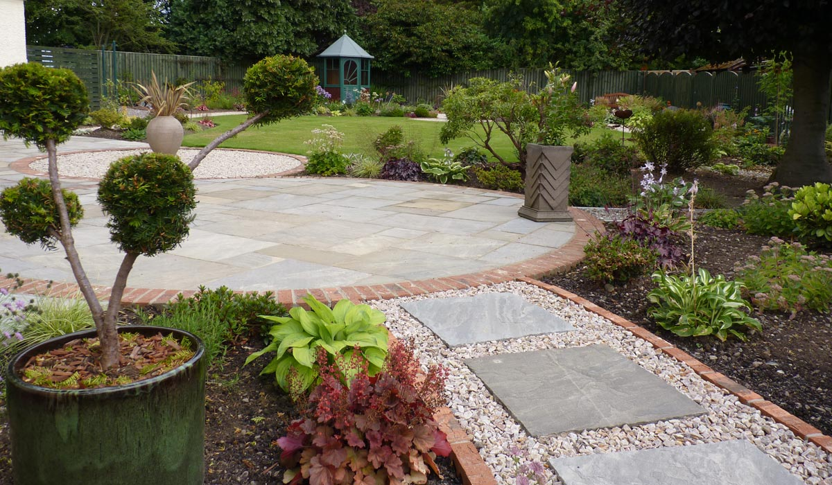 An eclectic mix of pots can work well in a garden to create features in different areas