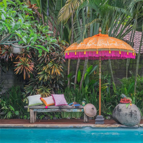 A colourful parasol will create a cool vibe in your garden