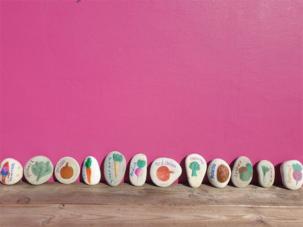 The painted stones are a beautiful addition to the garden