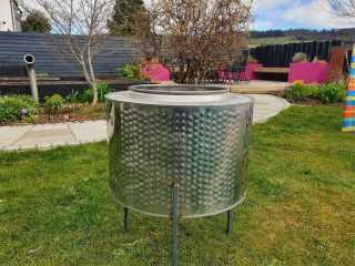 Our firepit made from an old washing machine drum
