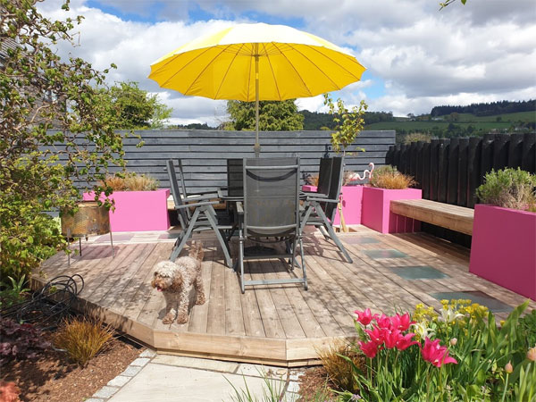 Add a parasol for a splash of colour to your garden