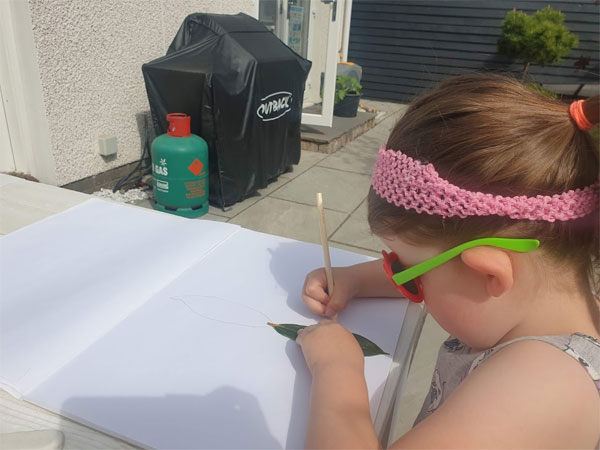 Carefully draw around the leaf allowing space for the full picture.