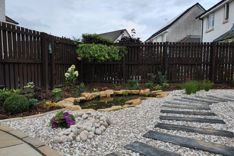 Timber effect sleepers lead through the gravel