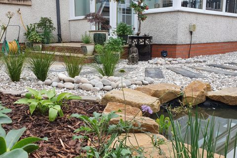 Lovely sandstone edging to the pond