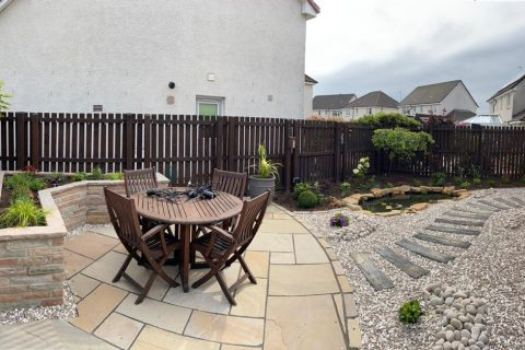 The sandstone patio is a beautiful place to relax