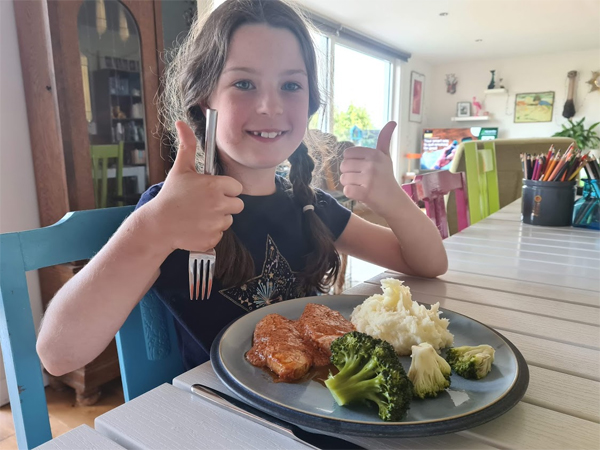 Our homegrown broccoli and potatoes get a big thumbs up from Lulu!