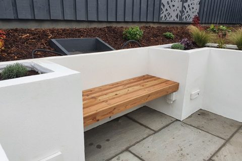 The built in seating within the new raised beds