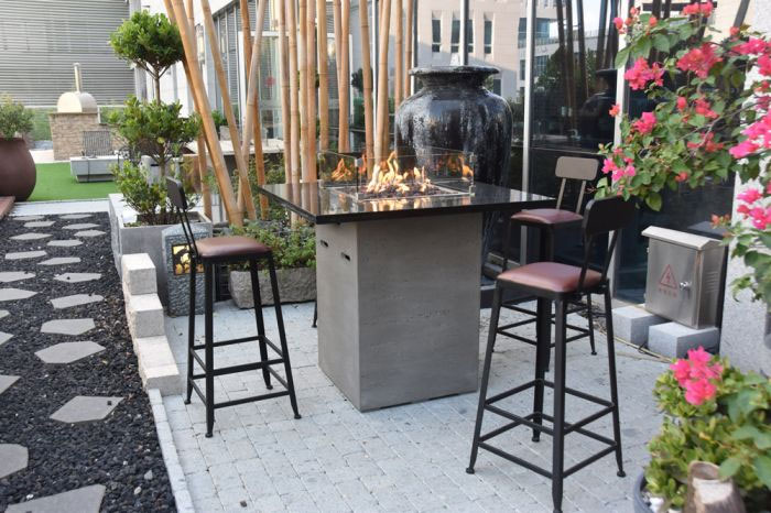 The ultimate transfiremation - a fire pit built into a bar table!