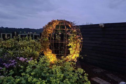 Uplighters highlight the globe at night