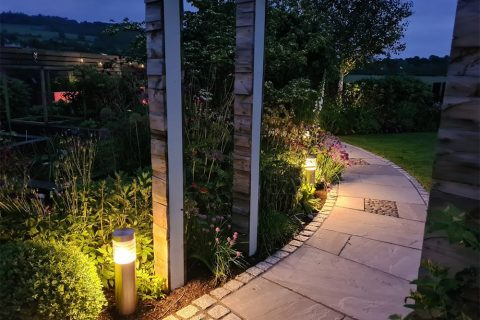Post lights create a lovely glow along the path