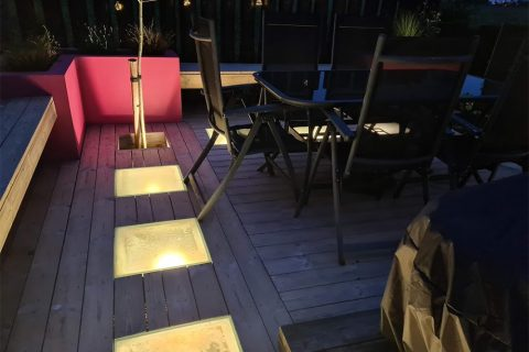 Large lights in the deck create a dramatic effect