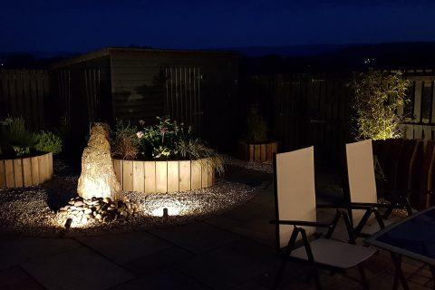 Uplighting highlights features & shrubs