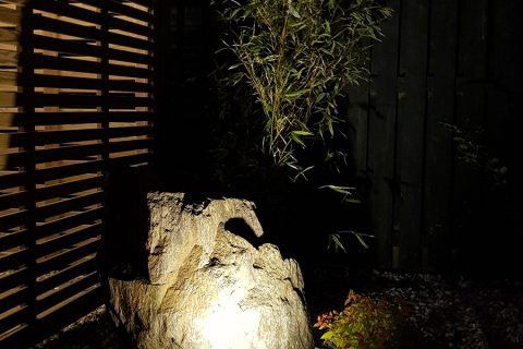 A feature rock lit at night