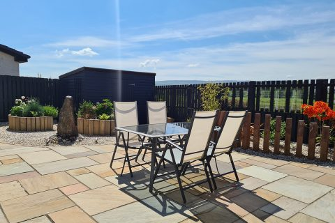 The new golden sandstone patio is the perfect spot to relax