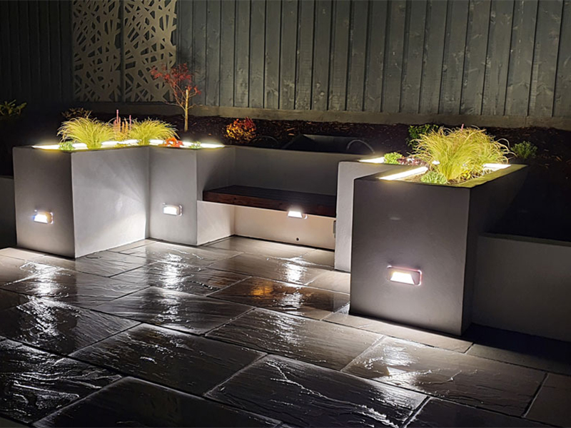 Brick lights set into raised beds looks amazing and light up your garden
