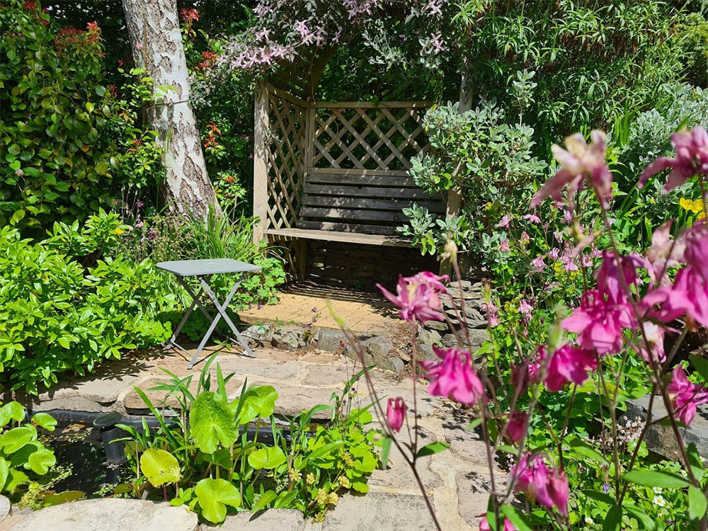 A relaxing water feature and arbour