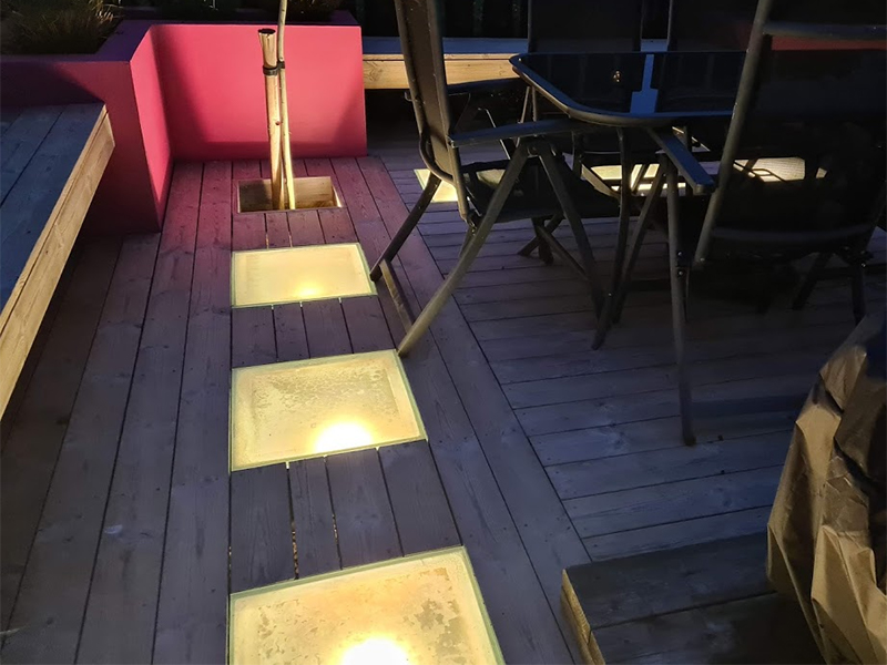 Add big lights to decking for dramatic effect