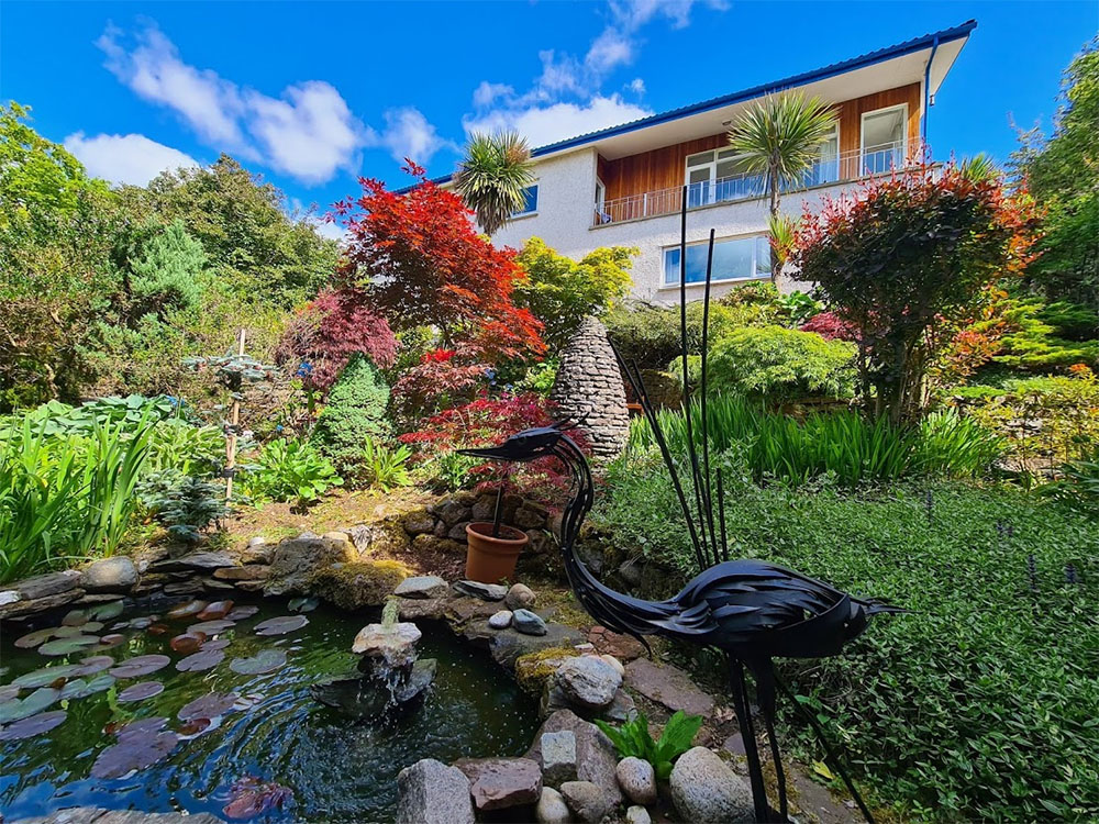 Stunning water feature, sculpture and planting